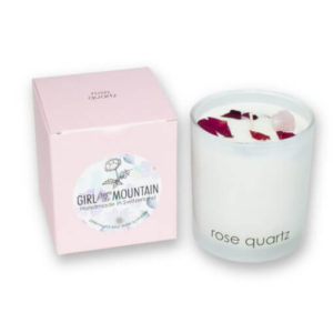 Rose quartz scented candle in a glass